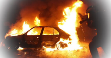 A commercial vehicle identified as Agofure Motors set ablaze by the Irate youths in Delta State